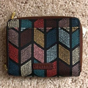 Brand new Fossil mini wallet with tags. Multicolor